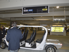 Level one of the ready and return area contains cars for Hertz, Dollar and Thrifty brands.