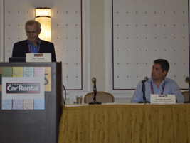 Jim Tennant (at podium) and Andres Lezcano of Bluebird Auto Rental Systems presented the key...