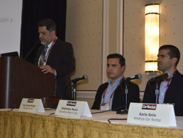 Eddie Crespo of TSD Rental (at podium) led this panel discussion on $1 rates in Latin America.