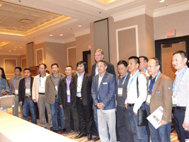 Chris Brown, executive editor of Auto Rental News, poses with the Chinese car rental delegation.