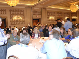 During Monday's roundtable discussions, attendees rotated between 10 tables with 10 different...