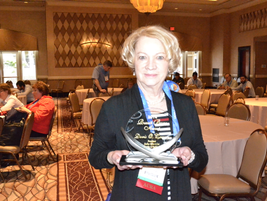 Doris Cassan poses with the Russell Bruno Award.