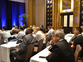 Attendees listen to a seminar in the ballroom.