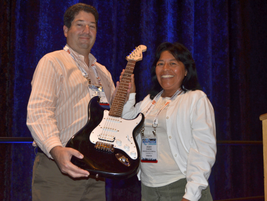 David Mayer of Advantage Rent A Car presented the Fender Guitar prize to Vicky Ramirez of...