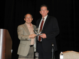 Chris Brown presented David Purinton of PurCo Fleet Services with this year's Russell Bruno Award.