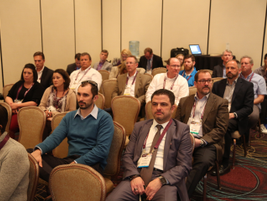 Attendees listen to a seminar during Auto Dealer Day.