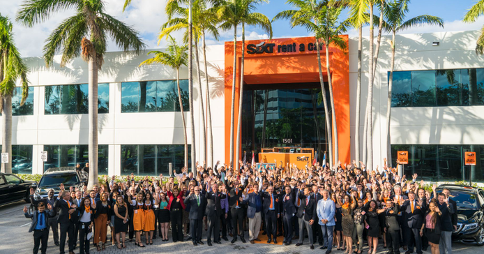 A crowd gathers at Sixt's new headquarters in Fort Lauderdale during the grand-opening ceremony.