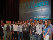 Chris Brown, executive editor of Auto Rental News, poses with thedelegation of 23 rental car...