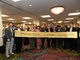 A delegation of car rental executives from China poses with Chris Brown, Sharon Faulkner and...