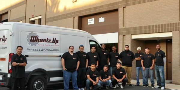 Jeb Lopez (far left) started Wheelz Up in 2012. The company delivers auto parts using Ford...