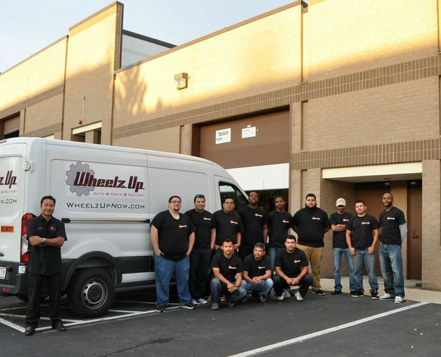 Jeb Lopez (far left) started Wheelz Up in 2012. The company delivers auto parts using Ford Transit and Nissan NV cargo vans serving markets in Texas, New York, Florida, California, and Washington, D.C. - Photo courtesy Jeb Lopez.