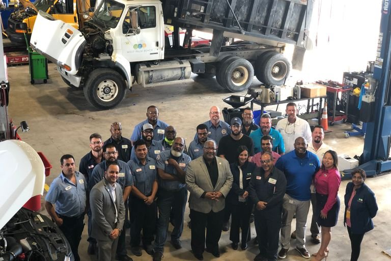 The Support Services Department for the City of West Palm Beach gathers in a less socially...