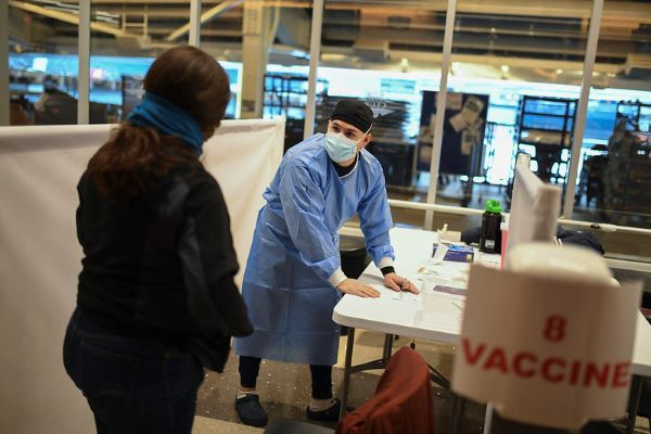 COVID-19 vaccinations take place at Yankee Stadium. Even when drivers are vaccinated, masks, cleaning and disinfection, and other mitigation measures will still need to be followed. - Photo via Flickr/ U.S. Air Force Reserve photo by Staff Sgt. Christopher S. Muncy.