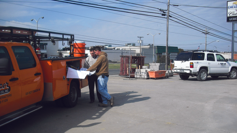 Aaron Vaal (left), a fleet salesperson for Uebelhor and Sons, makes an onsite call for a client,...