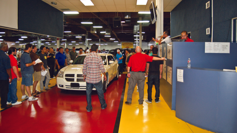 Photography by Chris WolskiDealers bid for cars during a closed sale at South Bay Auto Auction...