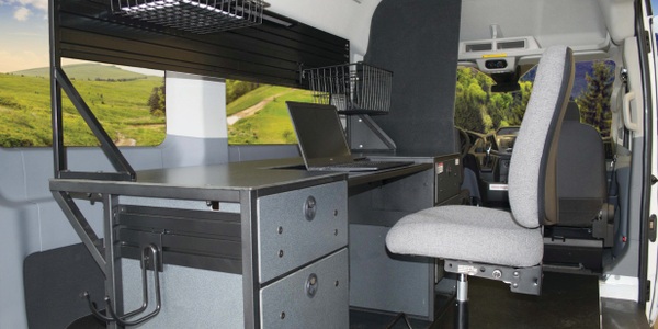 Ergonomic Solutions provided this Ford Transit van's mobile office equipment. The desk includes...