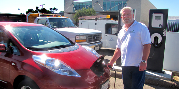 Jim Ruby of the University of California, San Diego charges one of the school's five Nissan...