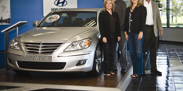 Standing next to the 2011 Hyundai Genesis are (l-r) Margie Johnson, administrator, fleet...
