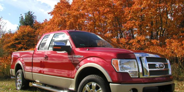 The 2009 Ford F-150 Lariat strikes a pose at Ford's Michigan Proving Grounds on a crimson and...