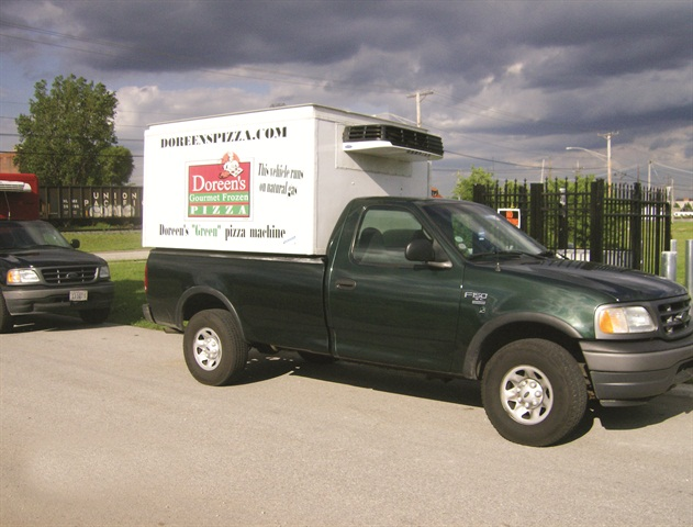 "Bob Wisz of Doreen's Pizza bought this 2001 factory-CNG Ford F-150 at auction and added the freezer box. While the CNG tank took away storage for about 16 cases of frozen pizza, the ""Green Pizza Machine"" branding on the side of the truck has been worth its weight in gold in free publicity."