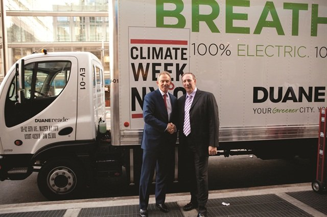 On the left, former UK Prime Minister Tony Blair and Paul Tiberio, Duane Reade senior vice president of merchandising and chief marketing officer, celebrate the NYC Climate Week.