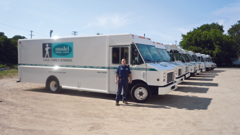 Joe Boyd stands with some of Grand Rapids, Mich.-based Model Coverall Services' delivery step...