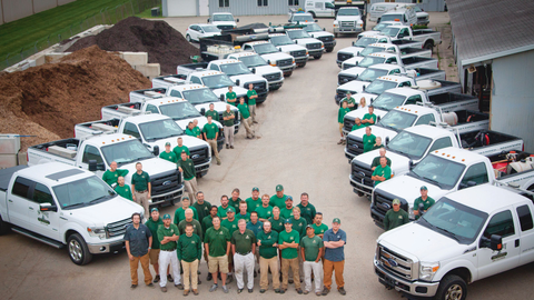 The Summit Landscape Management team with its truck fleet. Photo courtesy of Summit Landscape...