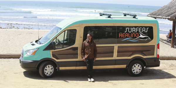 Izzy Paskowitz uses his 'woodie'-inspired Ford Transit to transport volunteers and equipment to...
