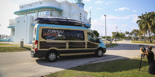 Surfers Healing's new Transit woodie-style van features a surf rack that can transport 10 tandem...