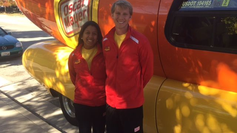 Hot Doggers (Jennifer Chow and Donald Knoelke) in front of the Oscar Mayer Wienermobile. Photo...