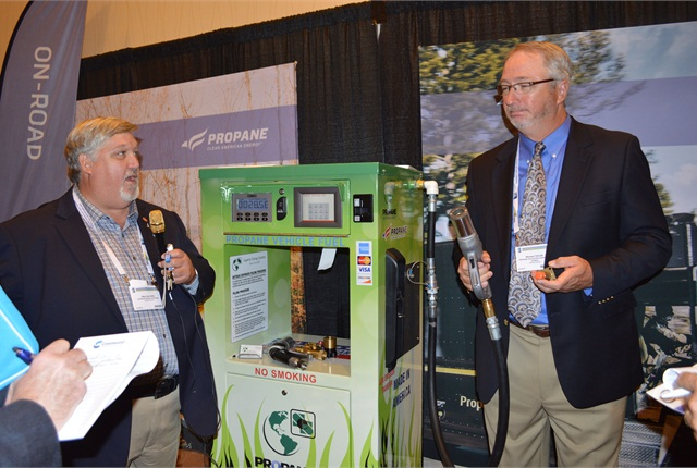 Mike Walters, vice president of safety and training at Superior Energy Systems, (left) demonstrates how his company's autogas dispensers work.