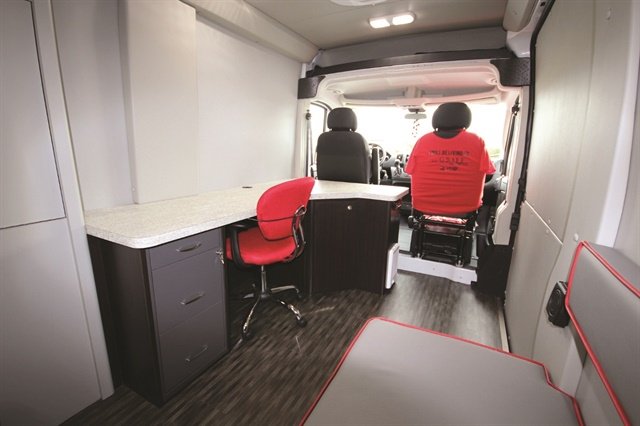 Creative Mobile Interiors customized this mobile leasing vehicle for Ohio-based Ardent Communities. The interior includes a desk, chair, bench-style seating for prospective customers, and an area to showcase floor plans of available properties. Photo courtesy of Creative Mobile Interiors.