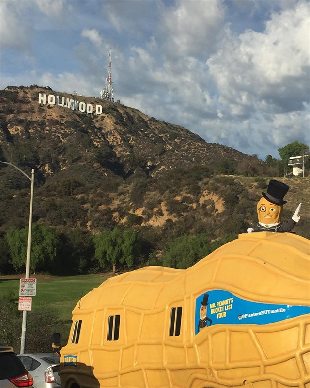 While touring Los Angeles, Mr. Peanut went for a ride by the Hollywood sign. Photo via @PlantersNUTmobile.