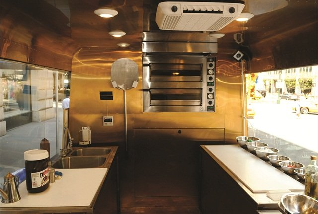 Each food truck's kitchen features state-of-the-art equipment that runs off electricity produced by the generator. The oven can cook pizza in less than 70 seconds.