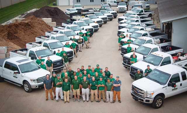 The Summit Landscape Management team with its truck fleet. Photo courtesy of Summit Landscape Management.