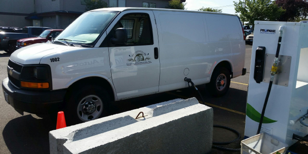 One of General Distributors' propane-powered cargo vans being refueled at its on-site propane...