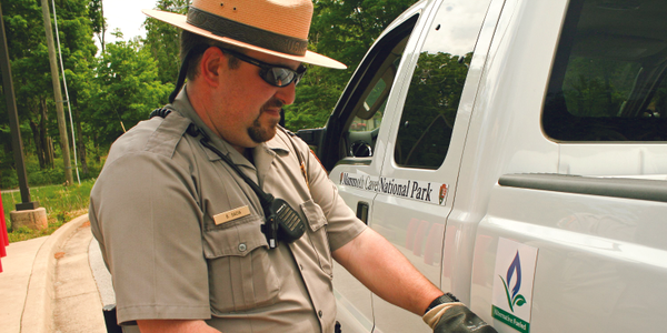 Brian Sacia, a Mammoth Cave National Park ranger, refuels one of the park's propane-powered...