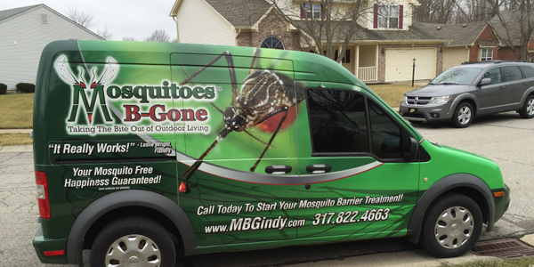 Mosquitoes B-Gone's vehicle wrap includes bright colors, mosquito graphics, and text such as its...