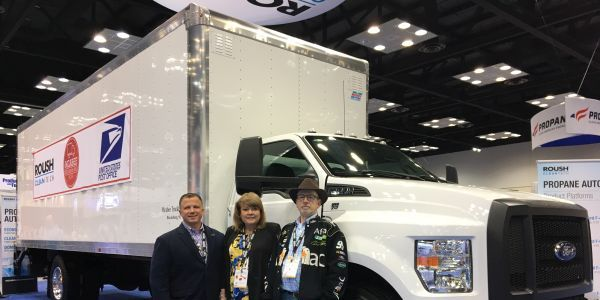 Todd Mouw (left) stands with Lisa McAbee of McAbee Trucking; and a McAbee truck driver at the...