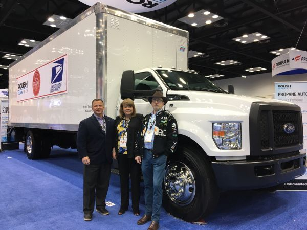 Todd Mouw (left) stands with Lisa McAbee of McAbee Trucking; and a McAbee truck driver at the 2020 Work Truck Show. McAbee purchased eight Roush propane Ford F-750 delivery trucks. - Photo by Chris Brown.