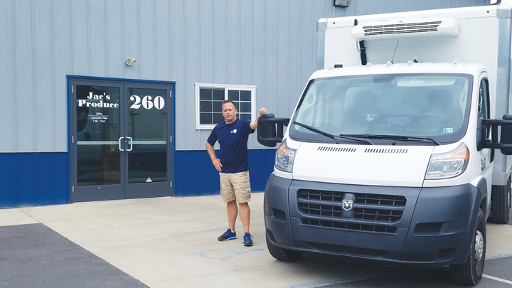 Gregory Anthony, owner of Jac's Produce of South Williamsport, Penn., stands with one of his refrigerated box trucks built on a Ram ProMaster chassis. With the onset of FSMA regulations, Anthony says the company decided to get rid of manual temperature logs and automate the process using a telematics-enabled temperature monitoring product. - Photo courtesy of Gregory Anthony.
