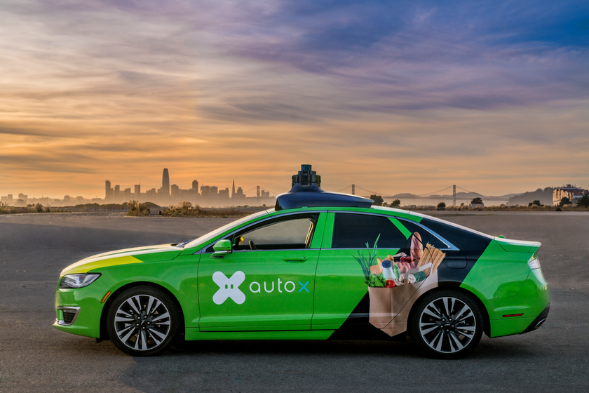 AutoX self-driving vehicles have built-in shelves with customers' orders and also commonly...