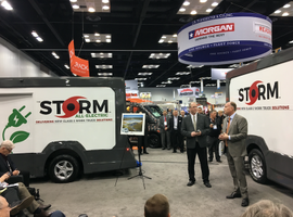 Rich Tremmel (right), Morgan Olson's vice president of sales and marketing, unveils the Storm,...