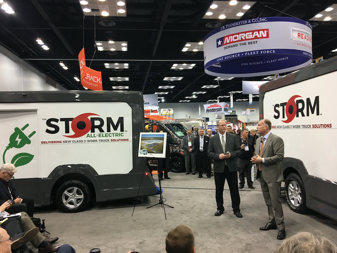 Rich Tremmel (right), Morgan Olson's vice president of sales and marketing, unveils the Storm, the company's new walk-in van. Storm eases driver shortage concerns as it falls under 10,000-lb. GVWR and outside DOT regulations. An all-electric version is planned. - Photos by Chris Brown.