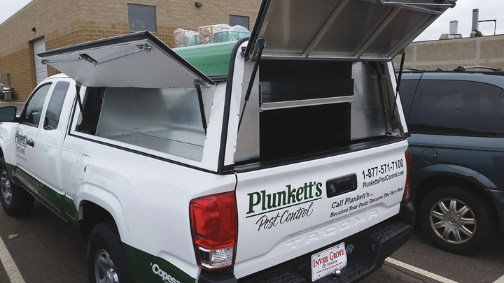 Plunkett's Pest Control uses customized truck caps and a custom storage solution that utilizes milk crates. The trucks have bed slides for easier equipment access. - Photos courtesy of Plunkett's Pest Control.