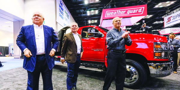 At NTEA's The Work Truck Show in March 2018, Chevrolet dealers Randy Marion (left to right),...