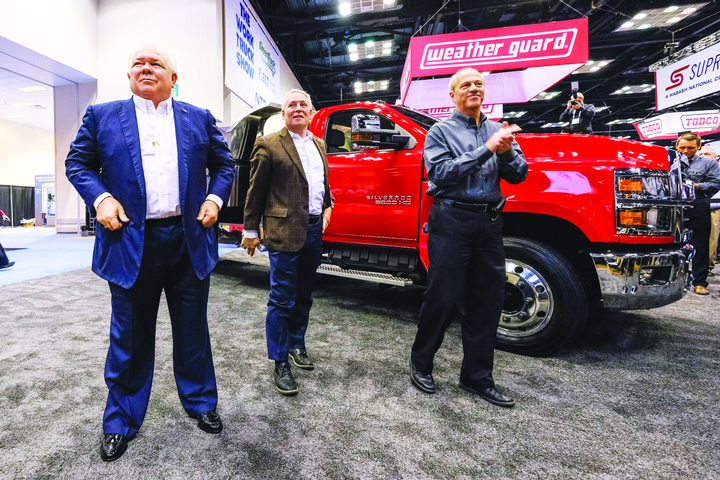 "At NTEA's The Work Truck Show in March 2018, Chevrolet dealers Randy Marion (left to right), Tony Uebelhor, and GM engineer David Arco celebrate the reveal of the Chevrolet Silverado 4500HD, 5500HD, and 6500HD. ""For us, GM re-entered the medium-duty market for the ability to be a one-stop shop,"" Uebelhor says. - Photo courtesy of GM."