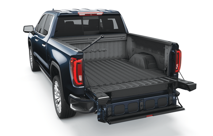 General Motors' GMC brand is heavily promoting its MultiPro tailgate with a marketing campaign featuring observers so struck by the product's cleverness that their jaws drop. - Photo via GMC.
