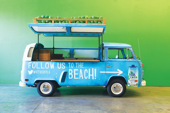 Specialty vehicle maker Cinema Vehicles decked out two 1973 VW buses with a beach vibe for Vita Coco. The buses were modified so the roof lifts up and the van becomes a bar with a coconut binon top and a wooden bartop inside, where productsamples are served. - Photo courtesy of Cinema Vehicles.