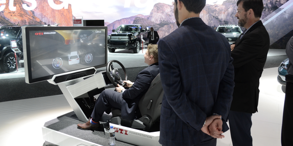 Media-ites drive a Volkswagen GTI - virtually - at the 2017 L.A. Auto Show. (Photo courtesy of...